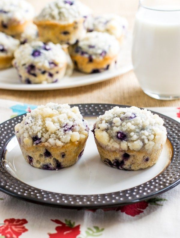 Blueberry Streusel Muffins: A moist, light, easy to prepare, bakery style blueberry muffin.  They are full of blueberries and covered in a buttery streusel crumb.