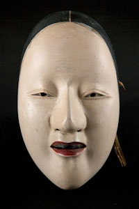 Theater mask in wood representing a woman (1800 - 1900)
