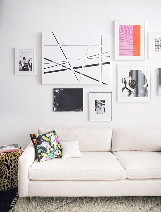 Collage of art above the sofa. Just make sure to pull in shades of green because of the olive curtain.