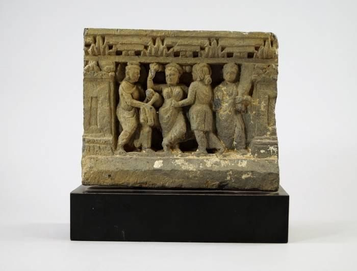 A Gandhara gray schist relief panel depicting the birth of Buddha, 2nd/3rd century, of rectangular form, central panel depicting figures and attendants, upon modern plinth, 19 cm high From Private Japanese Collection. - Price Estimate: £600 - £800