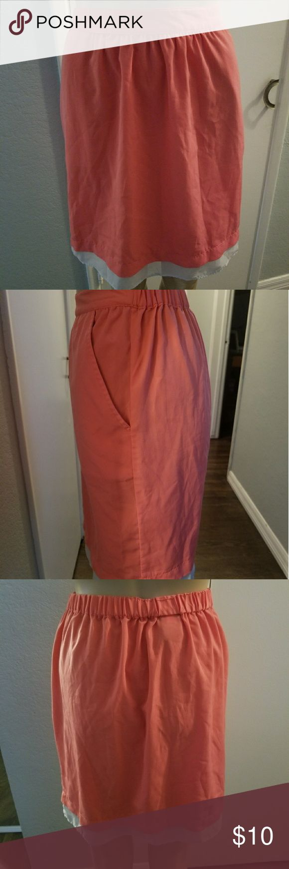 Skirt Coral knee length skirt with pockets, perfect to complete any summmer look. Has a grey underlining that peaks through at the bottom. Has no stains or rips. Mossimo Supply Co. Skirts Midi