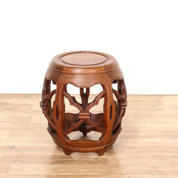 This garden stool is featured in a solid teak wood with a glossy finish. This Asian style stool has intricate carved sides, round top, and bottom tier. Can also double as a side table! #asian #chairs #stool #sandiegovintage #vintagefurniture