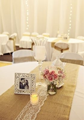 Rustic table decorations with burlap and lace.  Rehearsal dinner.  Mini pumpkins in globe hurricanes with curly willow for centerpieces.