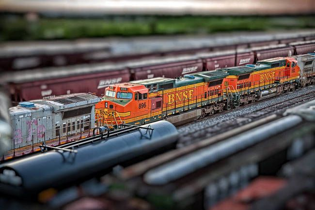 """""""BNSF train color print tilt shift saginaw texas"""" by Curtis Wheat, Saginaw, Texas // Wanted to get a shot that made the train look small.  As you can see in this shot we made something large look toyish. // Imagekind.com -- Buy stunning, museum-quality fine art prints, framed prints, and canvas prints directly from independent working artists and photographers."""