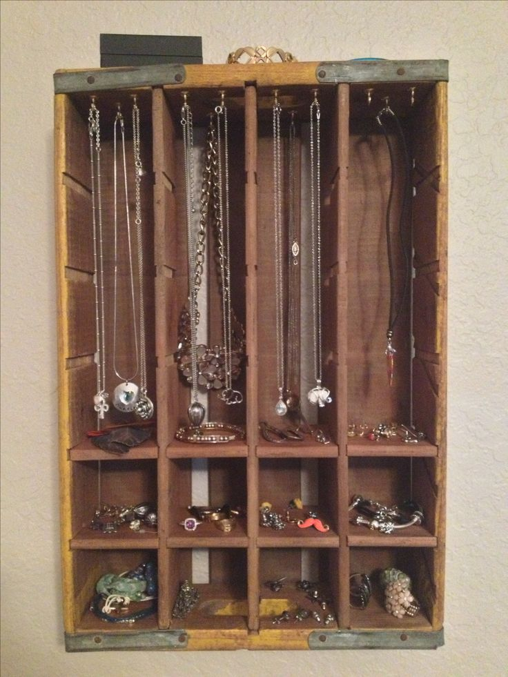 Old Coke crate turned into wall hanging jewelry organizer