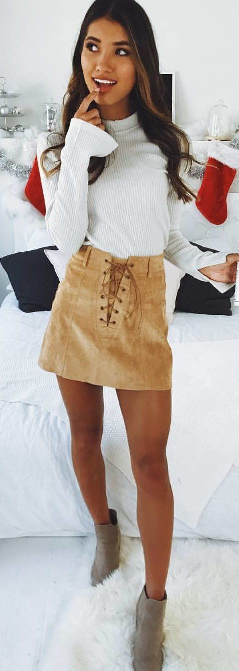 #winter #outfits white long-sleeved shirt and brown skirt