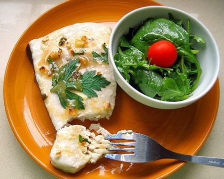 This is one of the easiest recipes to make delicious and healthy fish. It is also the way I prefer eating swordfish, as it reminds me of my childhood. My mom would always make it this way at home and when there was swordfish for lunch or dinner I would always be happy. This is a very good dish for children who do not enjoy eating fish too much, as swordfish steaks do not have bones. You can serve it with a simple green or tomato salad.