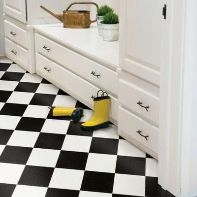 Black and white vinyl composition tile is a classic look in kitchens and mudrooms. | Photo: Courtesy of Mannington | thisoldhouse.com