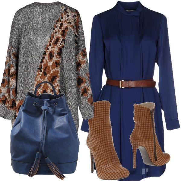 L accostamento di due colori strong da vita ad un outfit veramente grintoso. Vestito blu al ginocchio con cintura in vita. Cardigan lungo grigio con stampa animal. Stivaletti alti e zainetto sempre blu.