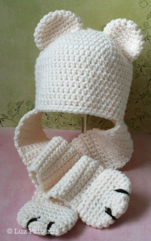 I used this scarf w/the paws idea on a couple hats I made.  They turned out adorable!  :)