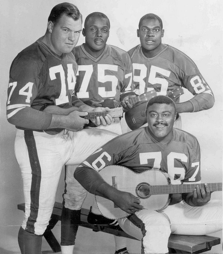 "1960's Los Angeles Rams Fearsome Foursome of Merlin Olsen, David ""Deacon"" Jones, Lamar Lundy,  and Roosevelt Greer"