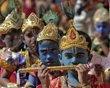 School children dressed as Hindu Lord Krishna take part in a function held ahead of