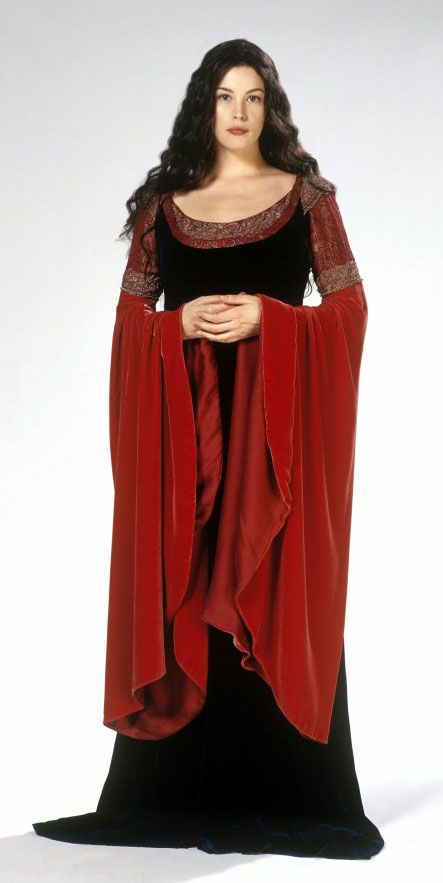 "Arwen (Liv Tyler) Lord of the Rings 2001.  The movie is filled with tons of beautiful costumes but the one to showcase Arwen in promotions for the films is what is called ""The Blood Dress."" The name is attributed to the gorgeous velvet bell sleeve. It has a red underdress with gold embroidery and a dark burgundy over dress."