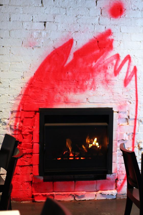 graffiti fire // Ladro, Melbourne.. maybe in orange/gold/copper behind the fireplace?
