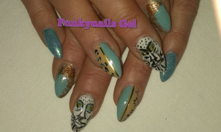My sculptured acrylic nails with free hand nail art!  #fun #nails #spring #colours #youngnails #acrylic #sculptured #nails #white #tiger #foil #gold  Join me on Facebook https://www.facebook.com/funkynailsgel/