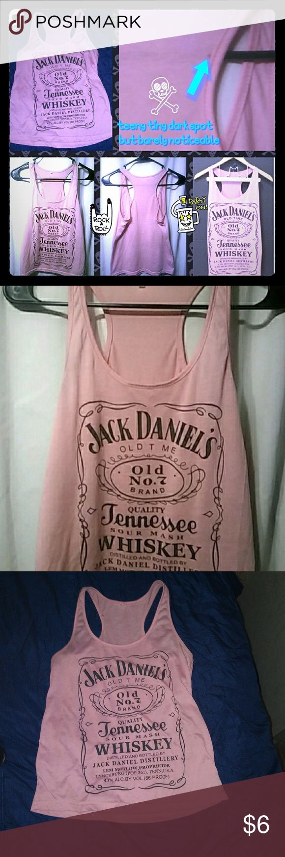 Jack Daniels pink Tank Jack Daniels pink racerback Tank size small little to no signs of wear except the small dot on the should strap which I pointed out in pick. Barely noticeable. Tops Tank Tops