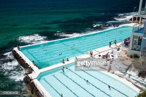 Swimmers do laps at the scenic Bondi Baths, also know as Bondi Icebergs. Sydney, New South Wales, Australia