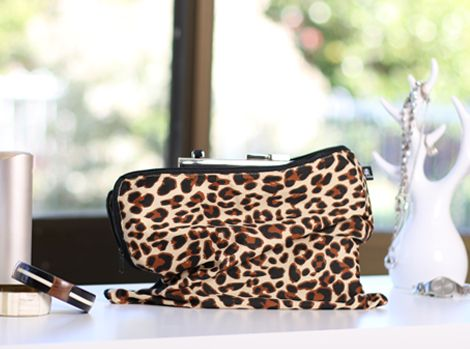Wallets, clutches and handbag storage in 100% Cotton Covers. Sassy. Bold. Beautiful. Zulu Leopard print displayed.