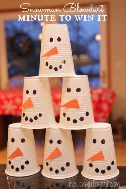 Winter Fun ~ Snowman Blowdart Minute to Win it Game Our family loves Minute to Win it Games!  They are great for a simple family night or a large crowd.  Plus you probably can use things you already have around the house.  Love that! The Challenge: To blow the snowman cup stack off table using