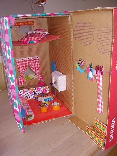 """Homemade dollhouse Love the """"outside"""" with crayon clouds and clothesline. via crafty crow"""