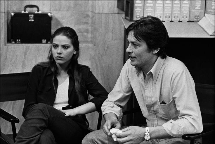 Alain Delon on the set of Mort d'un pourri; with Ornella Muti.