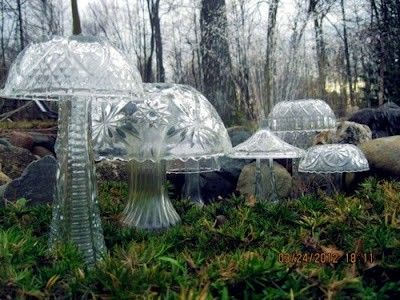 Yard sale finds:  cheap florist vases, bowls and light fixtures and waterproof liquid silicone as a glue makes crystal mushrooms for your garden.