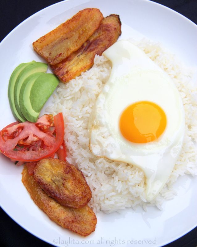 Arroz con huevo, or rice with a fried egg, is the ultimate Latin lazy lunch. Can also add fried plantains, avocado, and tomato onion curtido salsa.