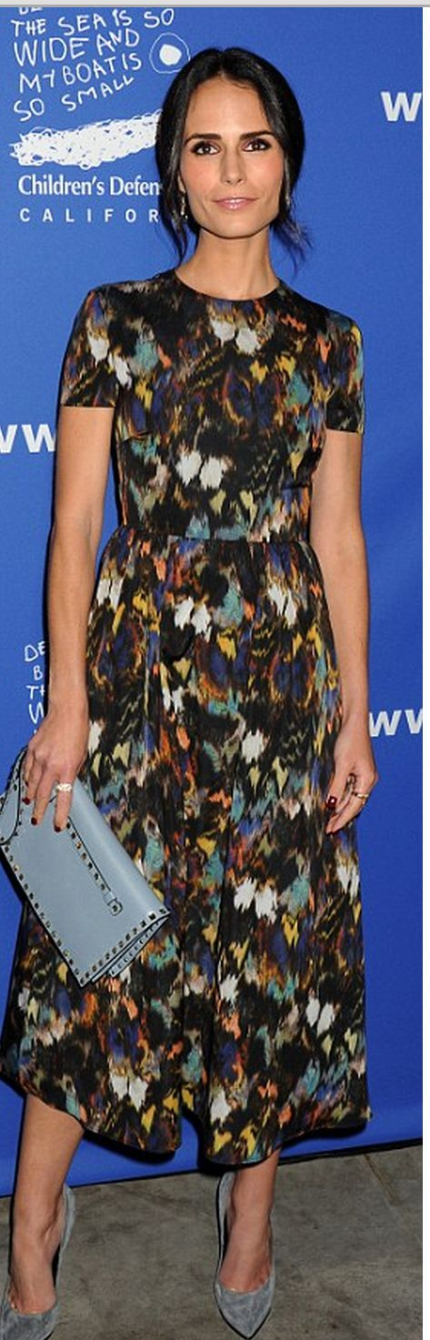 Jordana Brewster in Valentino with Valentino Rockstud Flap Clutch at Children's Defense Fund's 24th Annual Beat The Odds Awards on December 4, 2014.