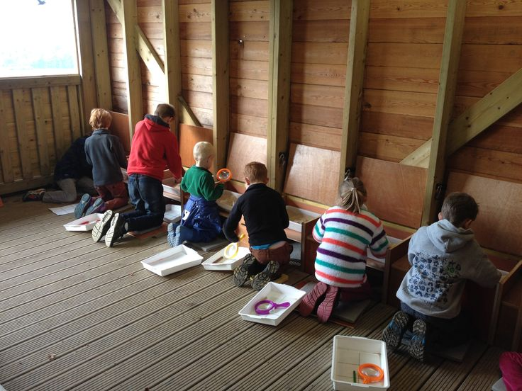 Fossil hunters hard at work. Catherine (BBOWT) Photographer: Claire