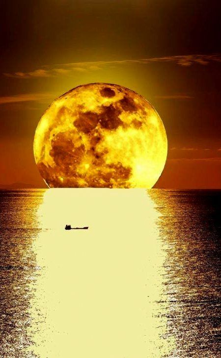 Moon sinking into the Aegean Sea located between the Greek and...