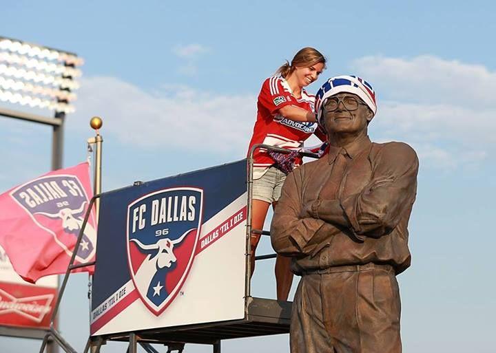 Tobin Heath puts the ceremonial scarf on the statue of Lamar Hunt at FC Dallas Stadium before FC Dallas' game against Chivas USA on July 4, 2013. (FC Dallas)