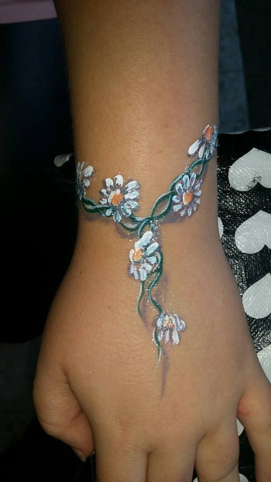 Cute daisy chain arm/face painting.  Great shadow work.