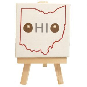 The word OHIO sits in the shape of the state of Ohio with hand-painted buckeyes as the letter Os.