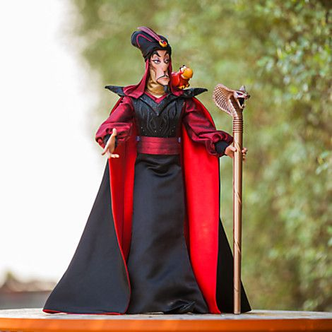 "Jafar Limited Edition 17"" Doll, 2015 ($120 at DisneyStore.com, sold out) - Jafar is draped in satin robes with cape and turban. Includes his cobra staff and pet parrot, Iago. This limited edition of 2,500 dolls, includes a certificate of authenticity. He wears a satin robe and cape with embroidered accents, faux leather collar and a turban with embroidered detailing. Includes his gold cobra staff with red gem eyes and Iago figure."