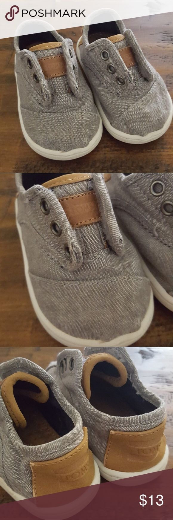 Baby Boys Gray TOMS Baby boys gray TOMS adorable slip on with velcro laceless shoes. GUC some signs of wear. Toms Shoes Baby & Walker