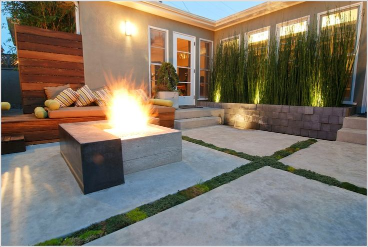 Fire pit area. Love the stone wall, could do this in front of the row of evergreens.