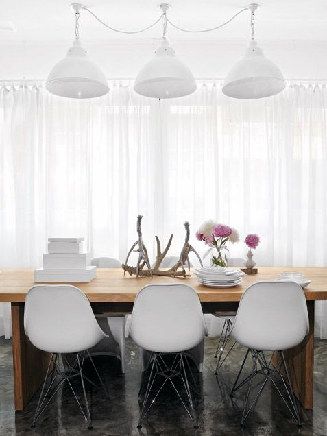 White on white. Gauzy curtains create a soft backdrop for a clean-lined table and chairs.