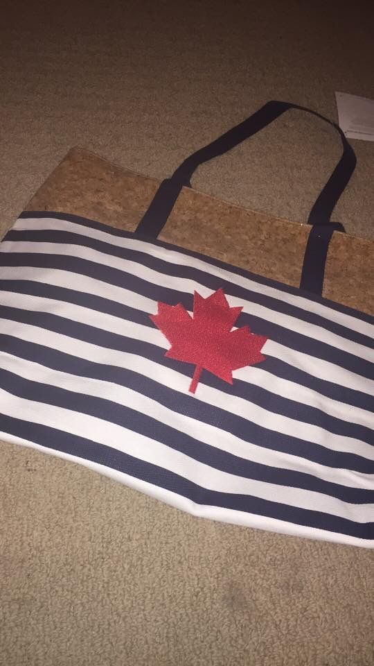 Getaway Tote with maple leaf icon-it in red.