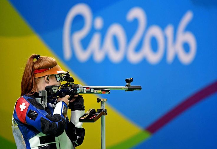 Nina Christen of Switzerland shoots during the women's 50-meter three position finals in the Rio 2016 Summer Olympic Games at Olympic Shooting Centre.  -  Best images from Aug. 11 at the Rio Olympics