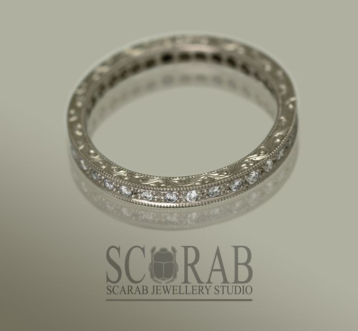 SCARAB's own Vintage inspired white gold and diamond eternity band.  hmmmm.. adorned with the most amazing engraving down the sides.  #scarabjewellery #rings #engraving #lovelocalza