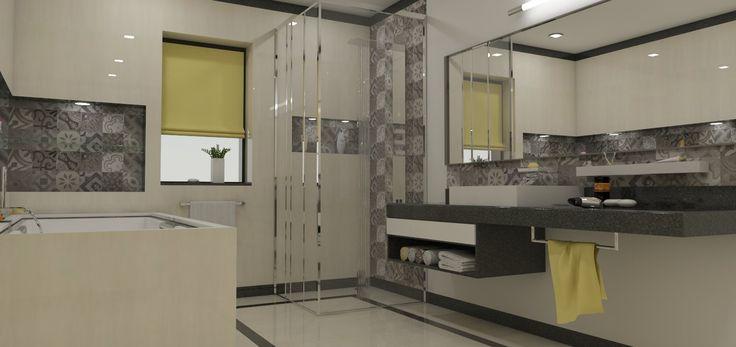 Dokonalá a priestranná kúpeľňa v odtieni sivej, ktorá je oživená trochou zelenej.