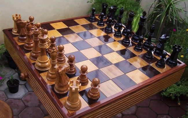 Handcrafted Teak Table With Inlaid Chess Board & Two Teak stoolshttp://goo.gl/5v3Cd9 #chess #chessboard #handcrafted #chesspieces #games