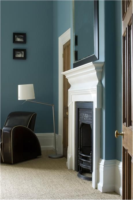 Lounge with walls in Farrow & Ball Stone Blue Estate Emulsion and woodwork in Wimborne White.