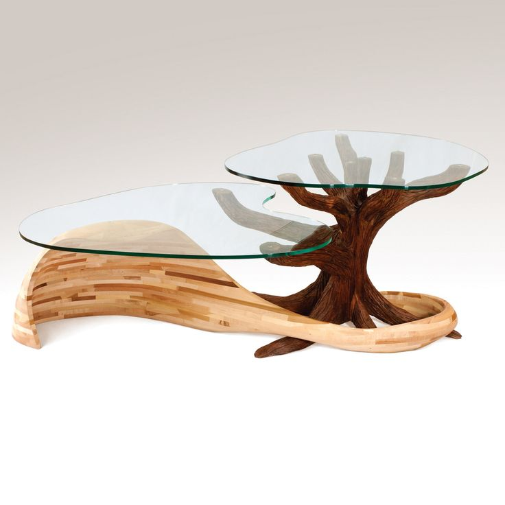 Land And Sea Coffee Table by Aaron Laux. The base is built from stack-laminated maple and walnut wood. The two forms nest together and support the glass tops. To clean use a feather duster and damp cloth.
