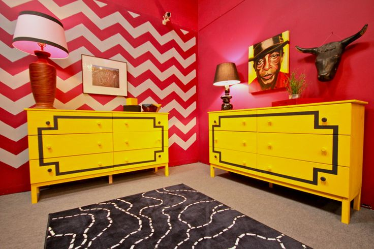 This bedroom totally has stripe hype because it showcases a candy pink and white Chevron pattern. We love the contrast of the yellow dresser against this zippy stencil design.Ex-Plosion! #cuttingedgestencils #chevron #design #allover #DIY #stencils #cute #red #white #power