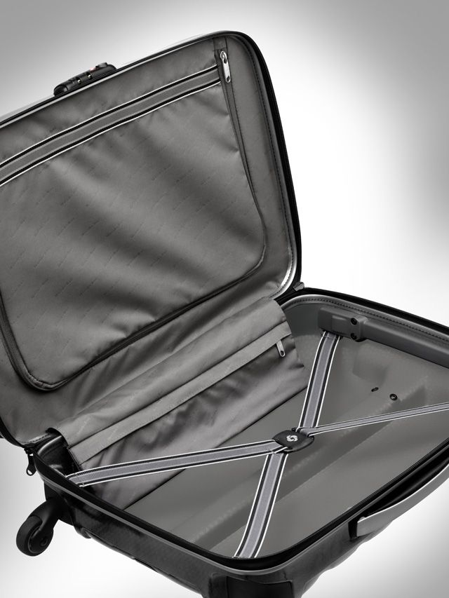 Firelite Spinner suitcase, charcoal. Material: Curv. Elasticated packing straps in lower compartment. Divider, trimmed with lining fabric, in upper compartment. Smooth and silent wheels. Three-digit TSA lock. Size: (cabin ready) approx. 40 x 55 x 20 cm. Weight 1.95 kg. By Samsonite for Mercedes-Benz.