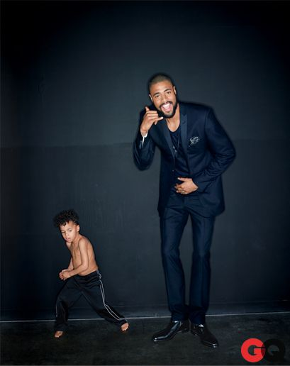 Tyson Chandler of the New York KNicks and his little man. Check the boots.