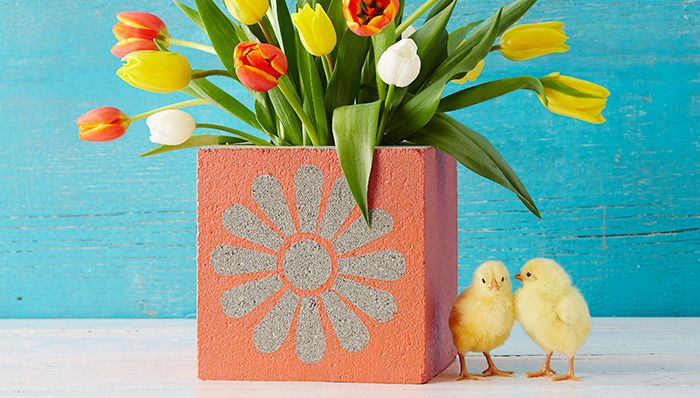Painted concrete block planter with chickens http://www.lowes.com/creative-ideas/lawn-and-garden/concrete-block-planter/project?cm_mmc=email_LowesCreativeIdeas-_-20140418-_-lm_36635-_-OSP1_BlockPlanter
