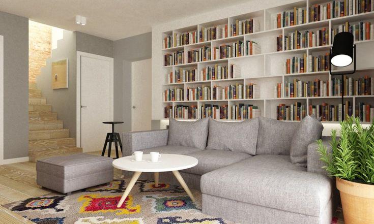 Nowoczesna sofa, stolik kawowy kojarzący się ze stylem skandynawskim i niektóre elementy, które można by przypisać...