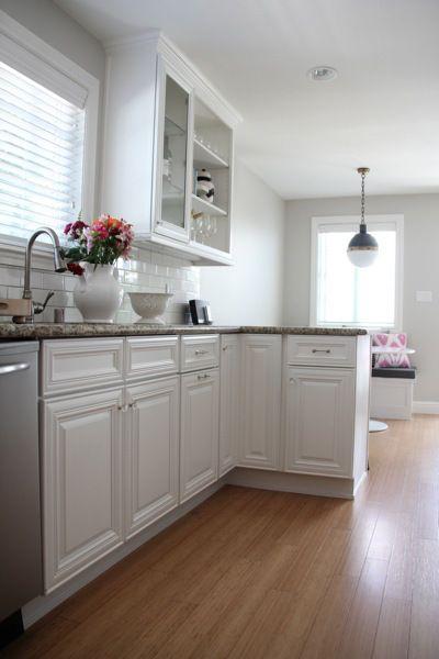 cabinet color: simply white benjamin more     wall color: revere pewter 50% formula Benjamin Moore